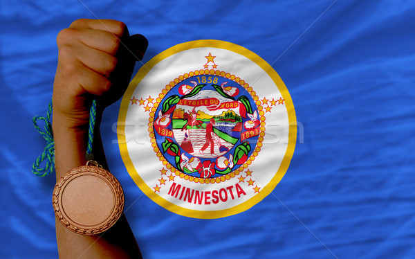 Bronze medal for sport and  flag of american state of minnesota  Stock photo © vepar5