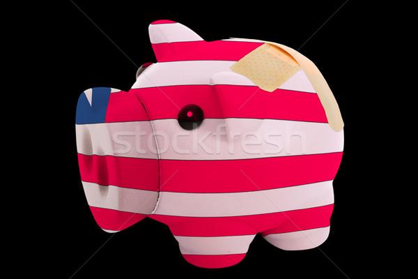 bankrupt piggy rich bank in colors of national flag of liberia   Stock photo © vepar5