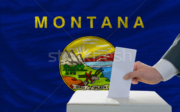 man voting on elections in front of flag US state flag of montan Stock photo © vepar5