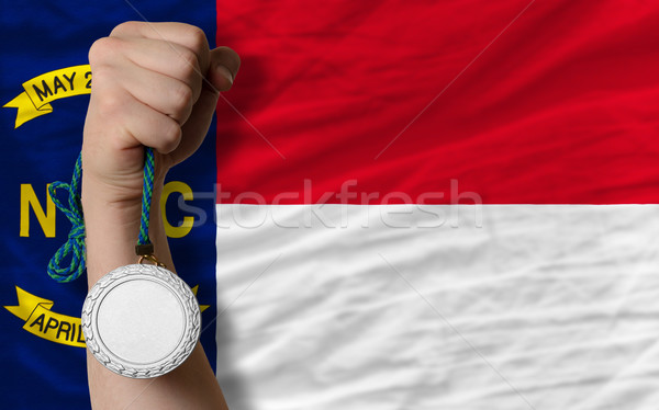 Silver medal for sport and  flag of american state of north caro Stock photo © vepar5