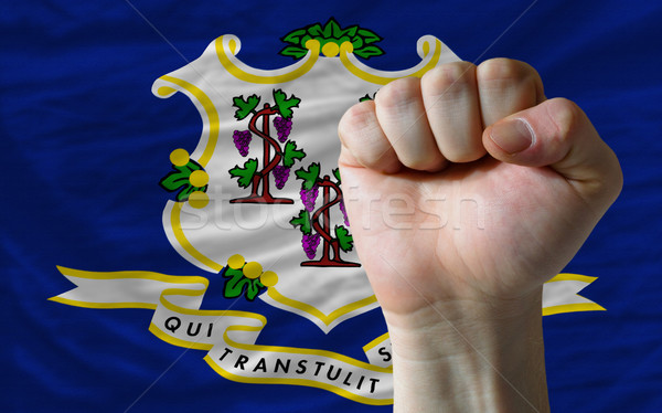 us state flag of connecticut with hard fist in front of it symbo Stock photo © vepar5