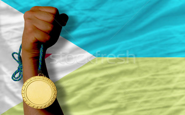 Gold medal for sport and  national flag of  of djibuti    Stock photo © vepar5