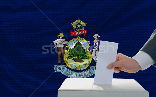 man voting on elections in front of flag US state flag of maine Stock photo © vepar5
