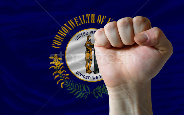 us state flag of kentucky with hard fist in front of it symboliz Stock photo © vepar5