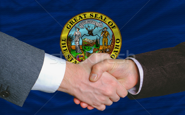 in front of american state flag of idaho two businessmen handsha Stock photo © vepar5