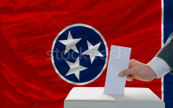 man voting on elections in front of flag US state flag of tennes Stock photo © vepar5