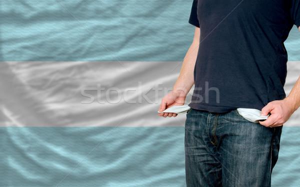 Recesszió fiatalember társadalom szegény férfi mutat Stock fotó © vepar5