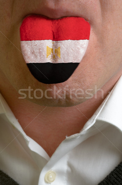 man tongue painted in egypt flag symbolizing to knowledge to spe Stock photo © vepar5