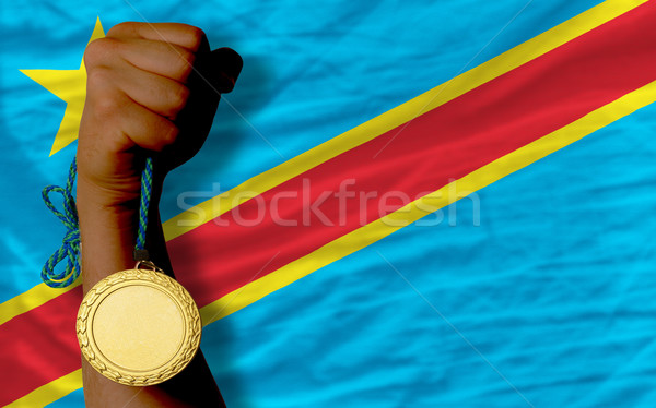 Stock photo: Gold medal for sport and  national flag of  of congo