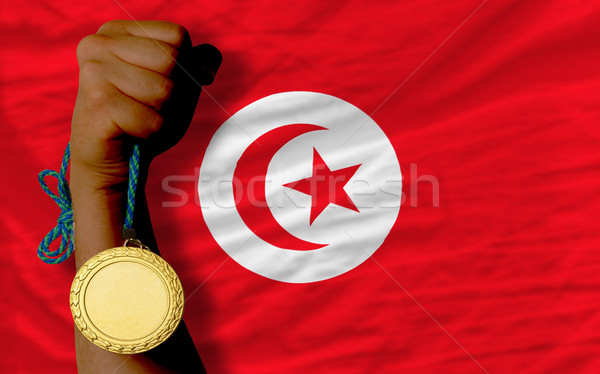 Gold medal for sport and  national flag of tunisia    Stock photo © vepar5