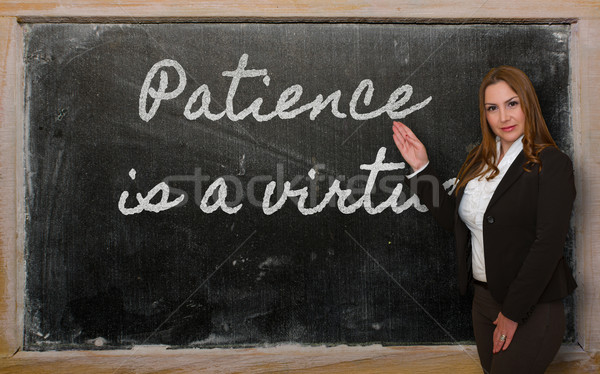 Teacher showing Patience is a virtue on blackboard Stock photo © vepar5