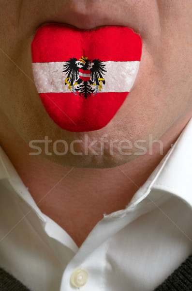 man tongue painted in austria flag symbolizing to knowledge to s Stock photo © vepar5
