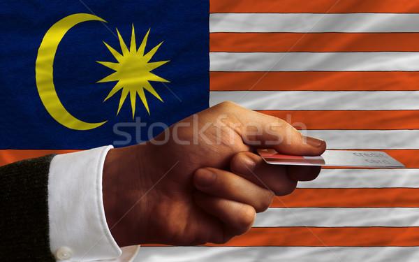 Compra cartão de crédito Malásia homem fora Foto stock © vepar5