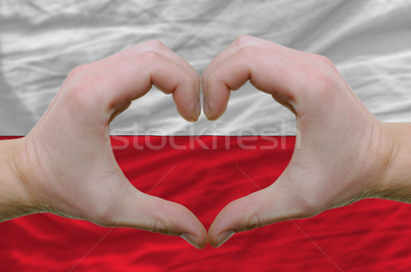 Heart and love gesture showed by hands over flag of poland backg Stock photo © vepar5