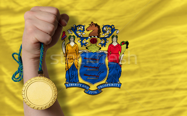 Gold medal for sport and  flag of american state of new jersey   Stock photo © vepar5