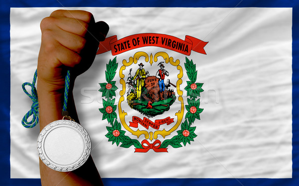 Silver medal for sport and  flag of american state of west virgi Stock photo © vepar5