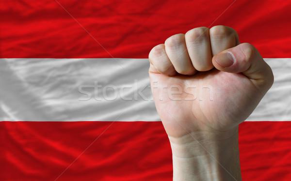 Hard fist in front of austria flag symbolizing power Stock photo © vepar5