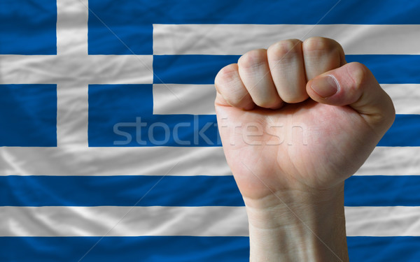 Hard fist in front of greece flag symbolizing power Stock photo © vepar5