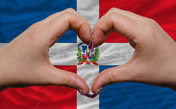 over national flag of dominican showed heart and love gesture ma Stock photo © vepar5