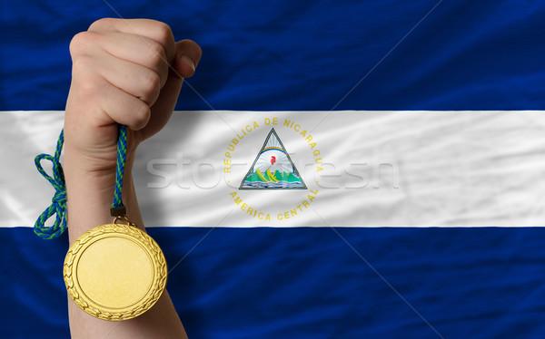Aranyérem sport zászló Nicaragua nyertes tart Stock fotó © vepar5