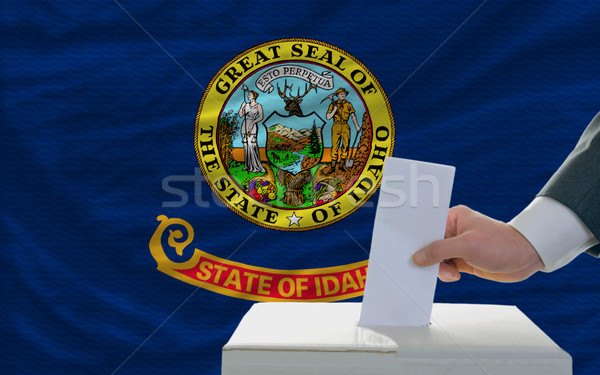 man voting on elections in front of flag US state flag of idaho Stock photo © vepar5