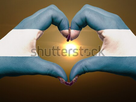Heart and love gesture by hands colored in kenya flag during bea Stock photo © vepar5