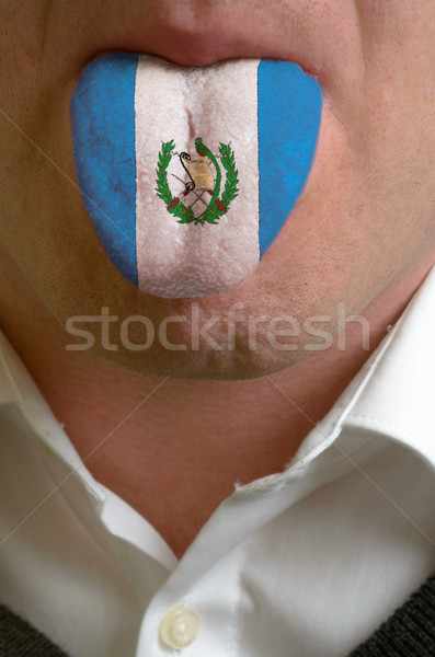 man tongue painted in guatemala flag symbolizing to knowledge to Stock photo © vepar5
