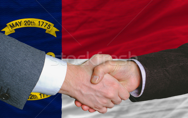in front of american state flag of north carolina two businessme Stock photo © vepar5