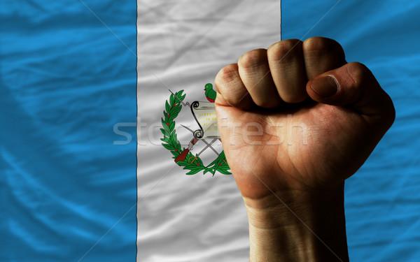 Hard fist in front of guatemala flag symbolizing power Stock photo © vepar5