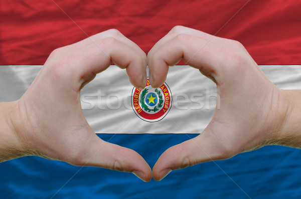 Heart and love gesture showed by hands over flag of paraguay bac Stock photo © vepar5