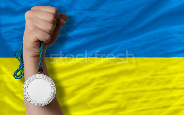 Stock photo: Silver medal for sport and  national flag of ukraine
