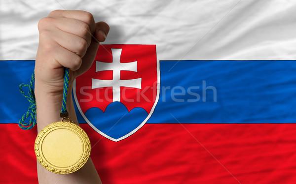 Médaille d'or sport pavillon Slovaquie gagnant Photo stock © vepar5