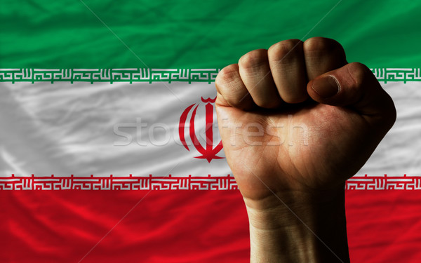 Hard fist in front of iran flag symbolizing power Stock photo © vepar5