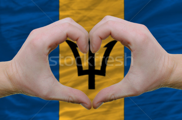Heart and love gesture showed by hands over flag of barbados bac Stock photo © vepar5