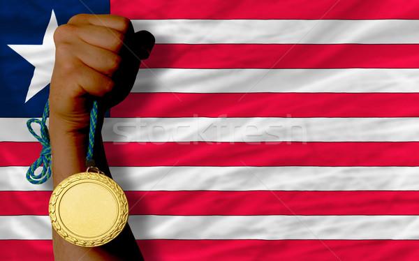 Gold medal for sport and  national flag of liberia    Stock photo © vepar5