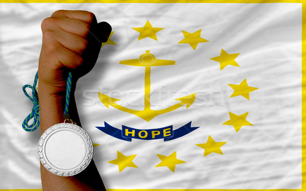 Silver medal for sport and  flag of american state of rhode isla Stock photo © vepar5