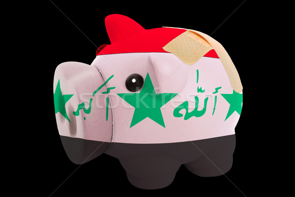 bankrupt piggy rich bank in colors of national flag of iraq    c Stock photo © vepar5