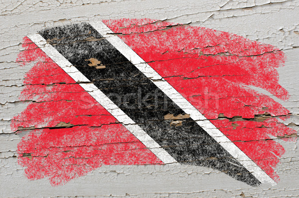 flag of trinidad and tobago on grunge wooden texture painted wit Stock photo © vepar5