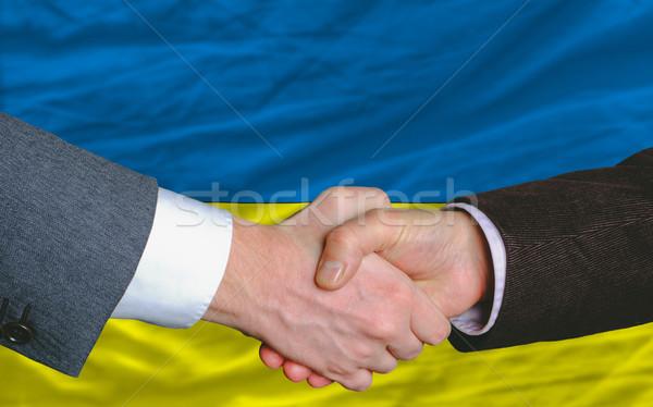 businessmen handshake after good deal in front of ukraine flag Stock photo © vepar5