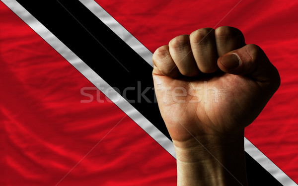 Hard fist in front of trinidad tobago flag symbolizing power Stock photo © vepar5
