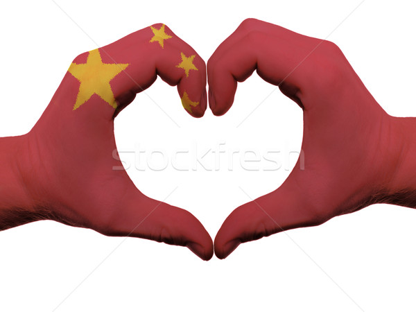Heart and love gesture in china flag colors by hands isolated on Stock photo © vepar5