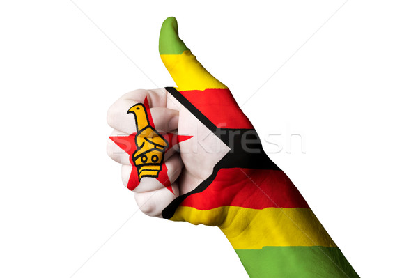 zimbabwe national flag thumb up gesture for excellence and achie Stock photo © vepar5