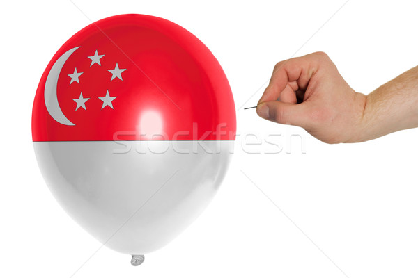 Bursting balloon colored in  national flag of singapore    Stock photo © vepar5