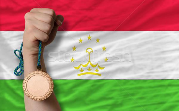 Bronz érem sport zászló Tádzsikisztán tart Stock fotó © vepar5
