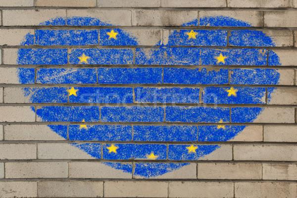 Forma de coração bandeira europa parede de tijolos coração Foto stock © vepar5