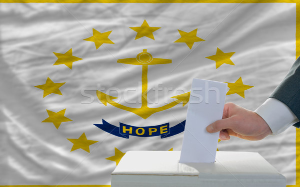 man voting on elections in front of flag US state flag of rhode  Stock photo © vepar5