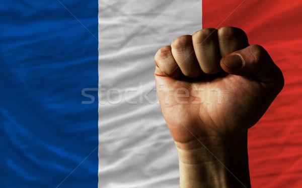 Hard fist in front of france flag symbolizing power Stock photo © vepar5