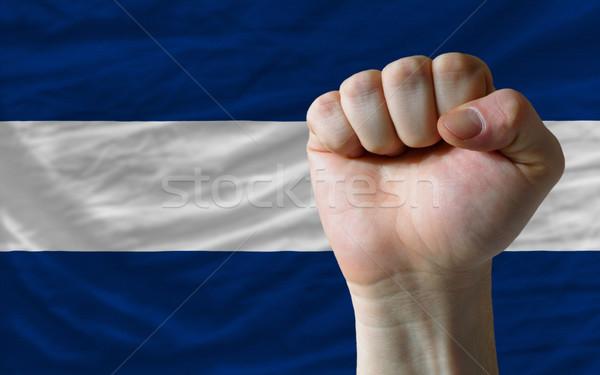 Hard fist in front of nicaragua flag symbolizing power Stock photo © vepar5