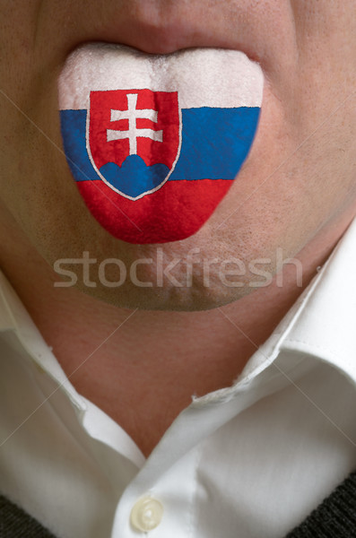 man tongue painted in slovakia flag symbolizing to knowledge to  Stock photo © vepar5