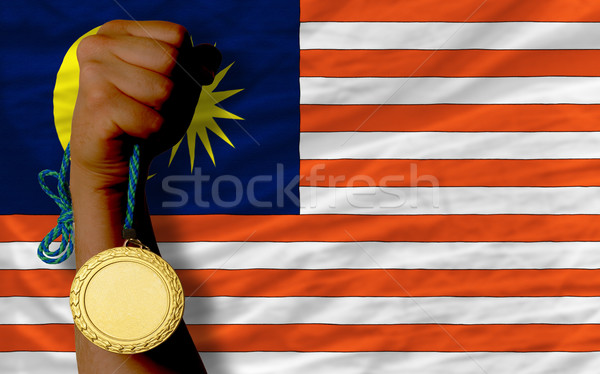 Stock photo: Gold medal for sport and  national flag of malaysia